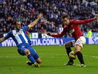 Ivan Ramis of Wigan Athletic in action with Robin Van Persie of Manchester United during the Barclays Premier League match between Wigan Athletic and Manchester United at DW Stadium on January 1, 2013 in Wigan, England.