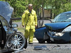 Woman injured, dog dies in Hatton Vale crash