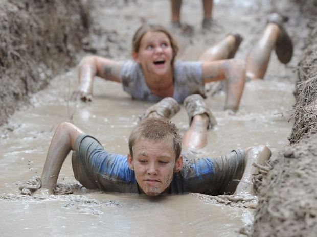 Dylan Hoskin and Jordan Sobczak from Western Australia get down and dirty in the obstacle course at the 2013 Australian Scout Jamboree.