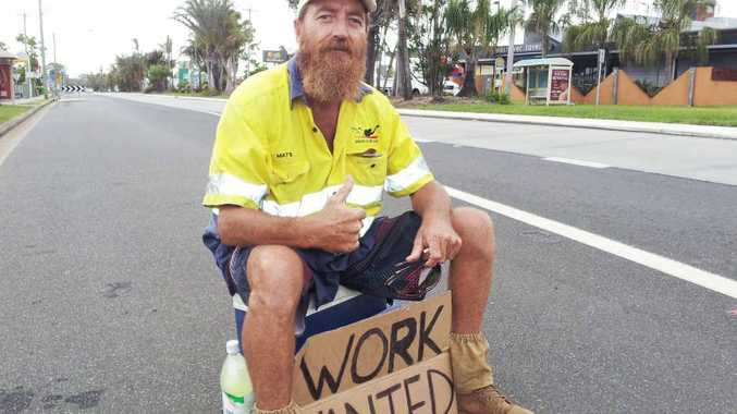 NOT SITTING AROUND: Deano Hill on the side of River St at West Ballina in an attempt to find work.
