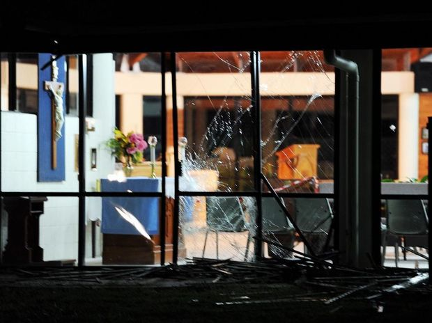 Hervey Bay Anglican Church's notice board was flatten and glass side of the building smashed by a vehicle that left the scene on Saturday night. Photo: Valerie Horton / Fraser Coast Chronicle