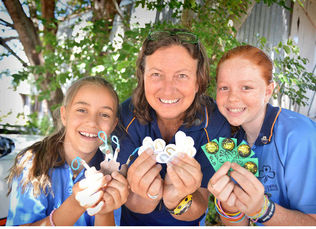 Rhiannon and Leonora Cox and Savanna Stey have their Gympie tokens ready to trade at the Australian International Guide Jamboree in Tasmania.