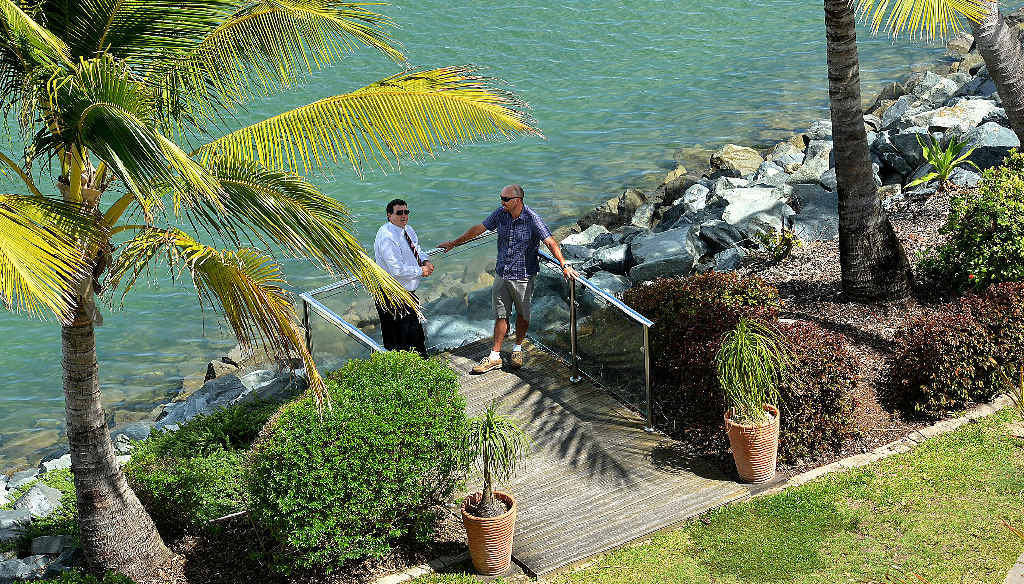 Clarion Hotel manager Shane Bowman (left) and Ben Anderson take time out at Mackay Marina, a popular tourist destination.