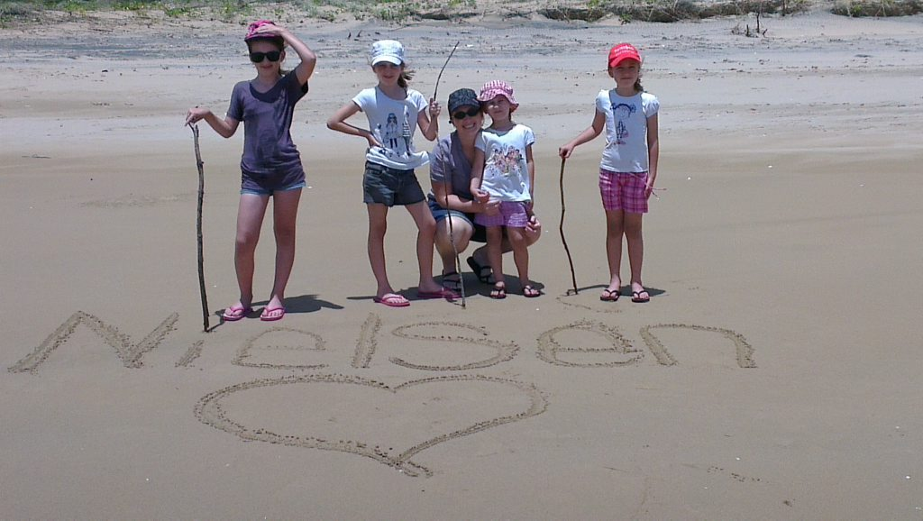 Renee and Amy Nielsen, Liz Carson, Brooke and Kayla Nielsen write their name in the sand on the LARC tour. Photo Liz Carson / NewsMail