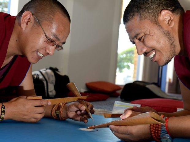 Phunysok Lhundup and Tenpa Gyamtso working on their sand art.