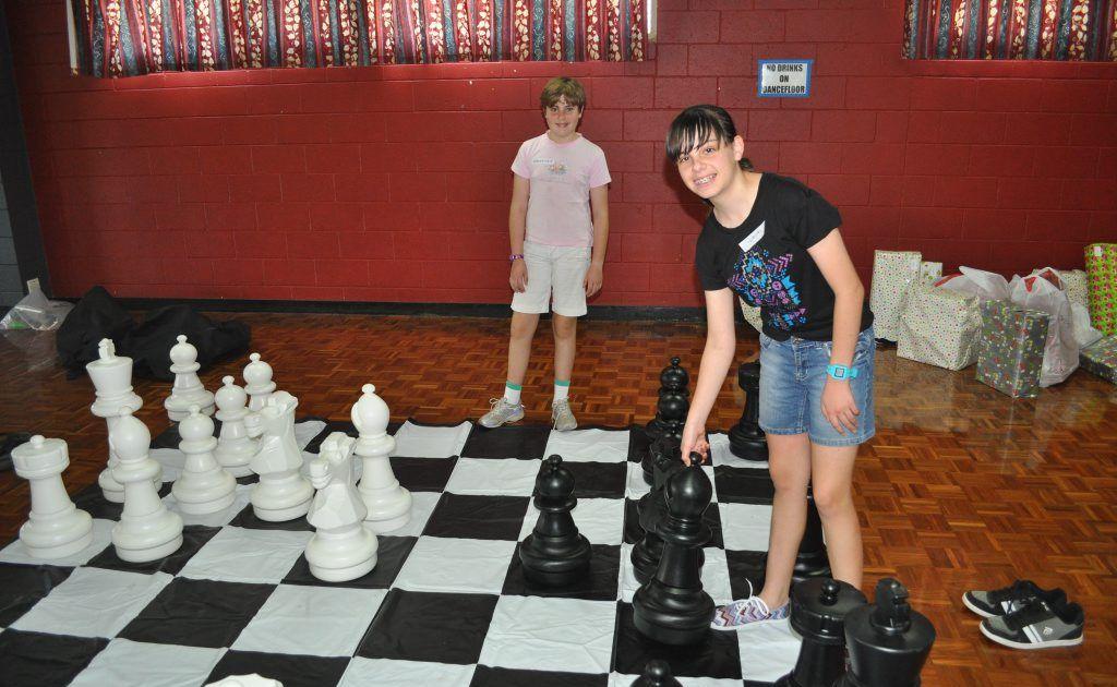 Mackenzie Guest, 10 and Laura Kane, 14 enjoyed the Beginner Chess Coaching Clinic SUNfest activity.