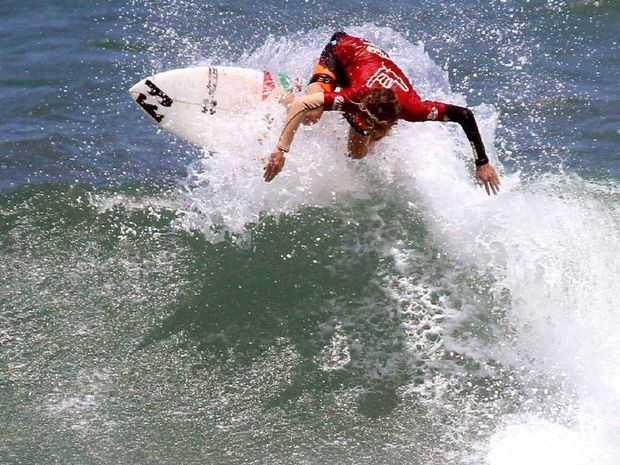 Moffat Beach's Reef Heazlewood heads for victory in the opening round of the under-15 boys' division at the Wahu Surfer Groms Comp at Coolum.