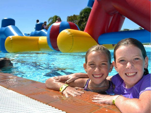 Lexie Guiver, 9, and Jenna Bright, 8, chill at the Caloundra Lifestyle and Aquatic Centre.