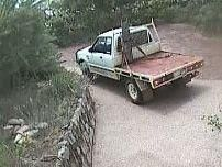 Police are looking for an older model two-door Ford Courier with a bull bar and a distinctive red tray back following a ramming incident in Karalee.