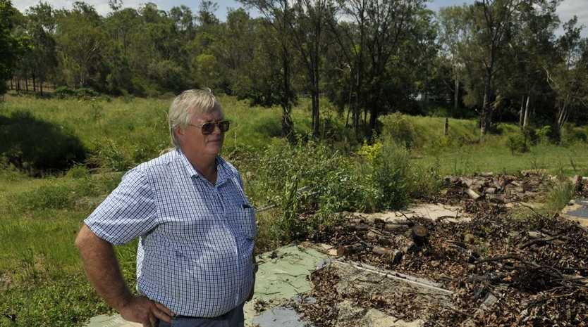 Ian James at the Postmans Ridge site where his mother Sylvia Baillie was killed during the 2011 flood disaster.
