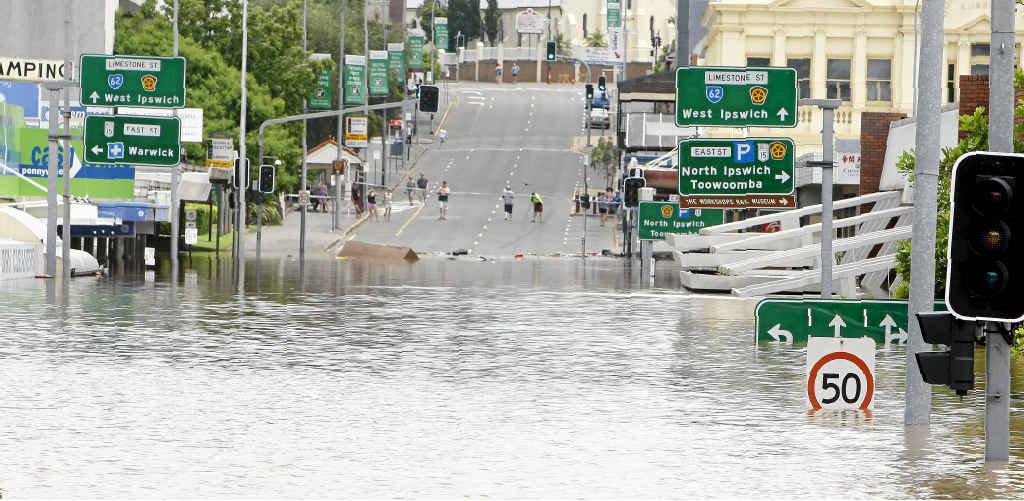 SWAMPED CITY: Floodwater over Limestone St in the Ipswich CBD about 11:30am on January 11, 2011.