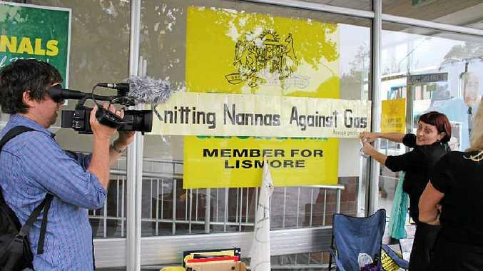 ZOOMING IN: Cameraman Tony Jackson, filming in Lismore for Al Jazeera in October last year.