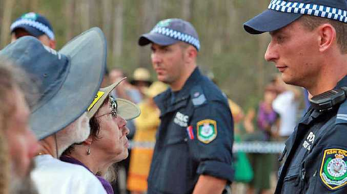 FACE OFF: Police confront protestors at Glenugie, most of whom were local residents. The average age of the six people kept in custody overnight was 55. PHOTO: Jimmy Malecki