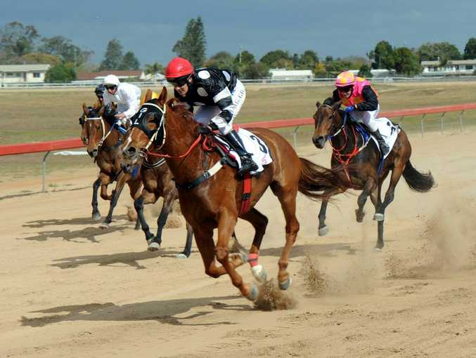 Desiree Gill leads the pack on Mister Chipper in the NAB Plate over 1090m at Thabeban Park on Ulton Cup Race Day, September 15, 2012
