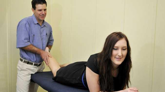 Physiotherapist James Wiltshire treats Laura Wyvill.
