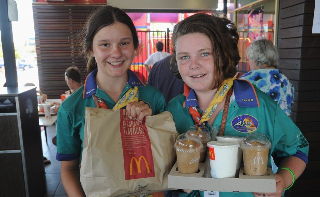 Scouts Elsa McConvill and Kristen Watkins pick up some McDonald's during the 2013 Scout Jamboree.