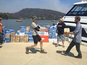 Volunteers help with the relief effort in 40 degree heat.