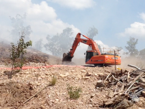 Workers extinguish fire at dump
