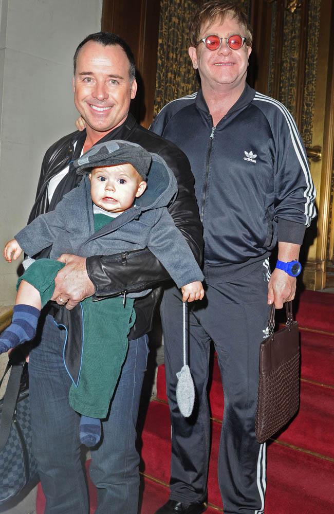 Elton John, David Furnish and baby Zachary.
