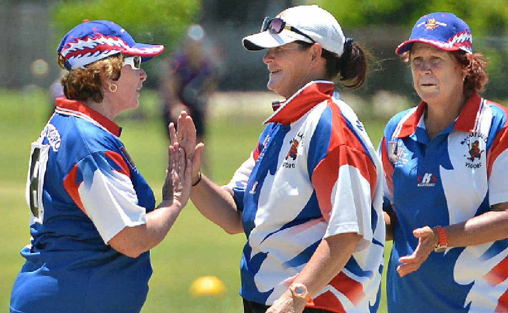 Mackay's Kerryn Nash gets a wicket and is congratulated by teammates Karen Ihle, left, and Narelle Milligan.