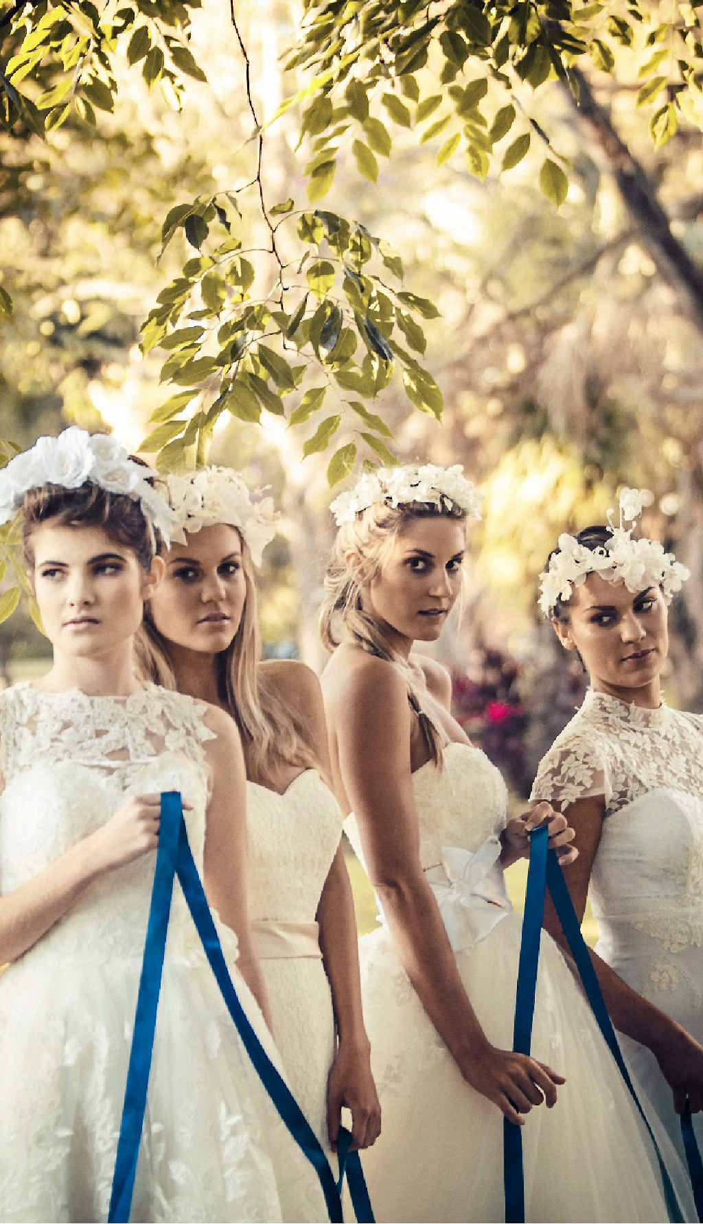 Mia loves the 1920s for brides with lace caps, long veils and bridesmaids with shorter gowns.