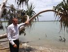 Fraser Coast councillor Trevor McDonald stands on the Point Vernon foreshore near Eli Creek where crocodiles were reportedly sighted.