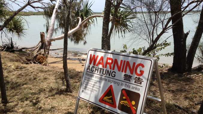 A sign at Point Vernon warning against swimming after crocodiles were reportedly sighted in Eli Creek.