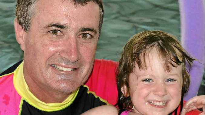Gavin Stewart and his daughter Tia cool off at WIRAC in Warwick yesterday.
