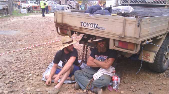 Glenugie farmers chained themselves to a ute blocking access to the drilling site yesterday
