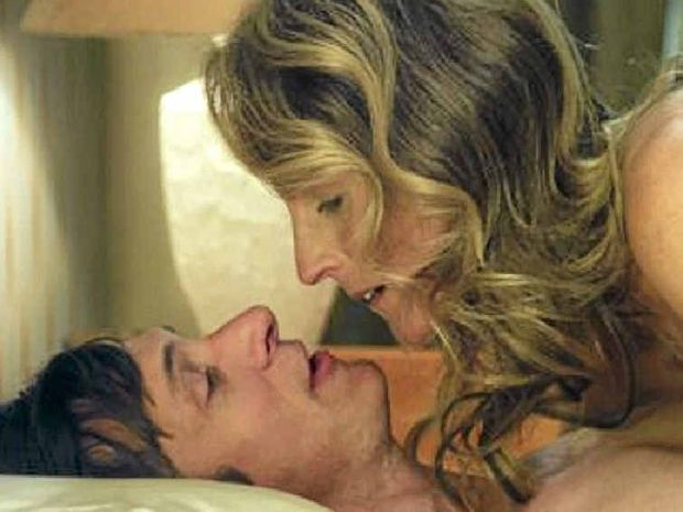 A scene from the movie The Sessions with John Hawkes and Helen Hunt as a sex surrogate.