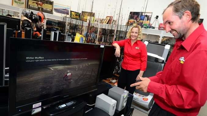Tracey and Ross Benham at their family owned business Speedi Cash in Rockhampton.