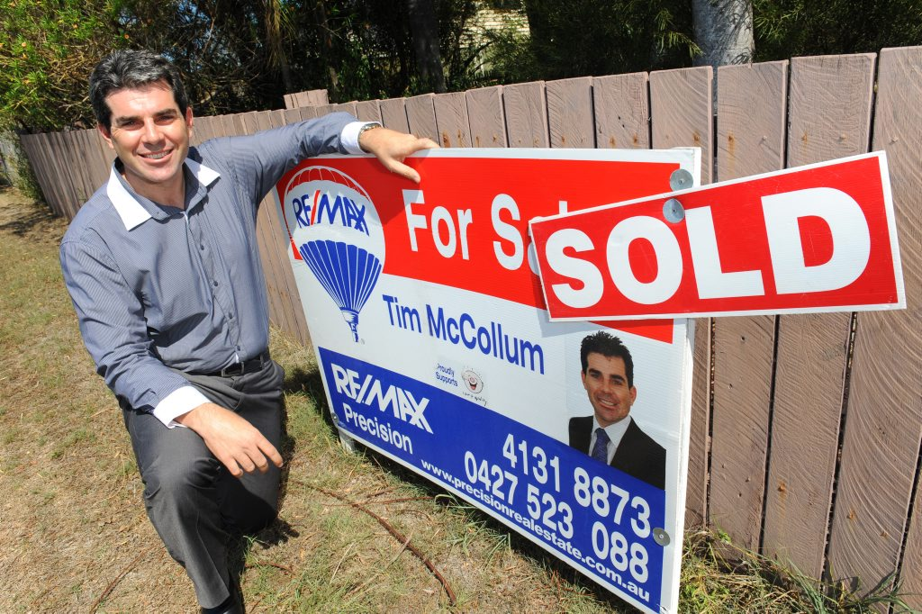 Remax's Tim McCollum outside the Bargara Rd residential property he recently sold to an investor.