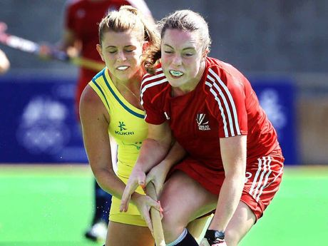 Australia's Jordyn Holzberger and Grace Balsdon of GB battle for the ball during the Women's Hockey match on day one of the 2013 Australian Youth Olympic Festival.