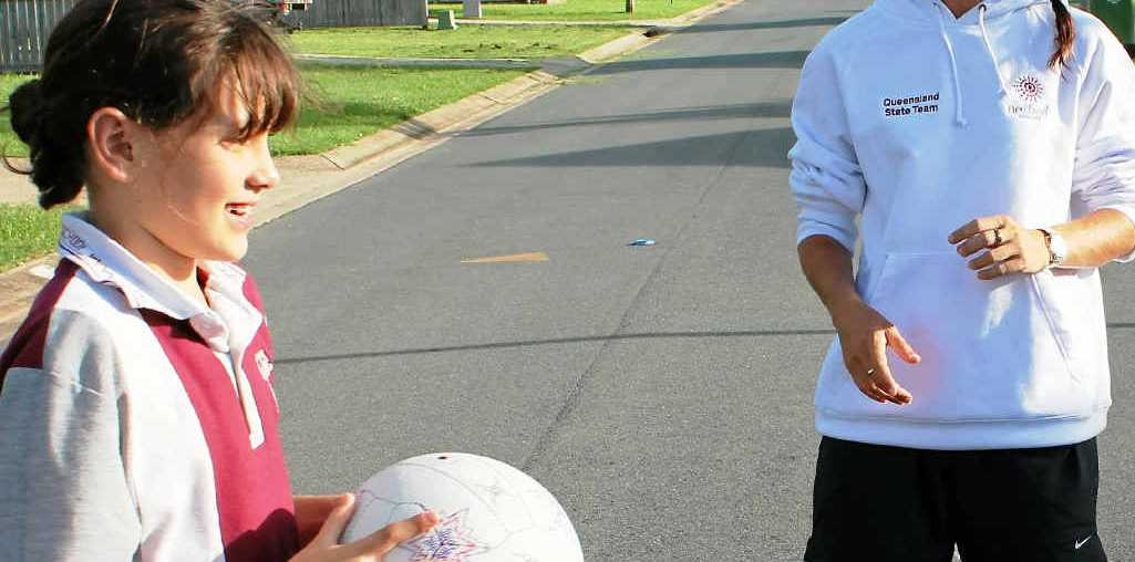 GREAT TIPS: Coach Carynne Robinson passes on some netball skills to Kiara Sinn.