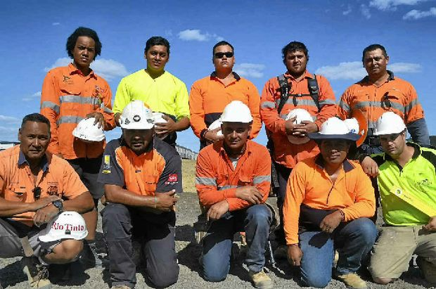 RESCUERS: A group of New Zealand construction workers, including those who saved a man's life.