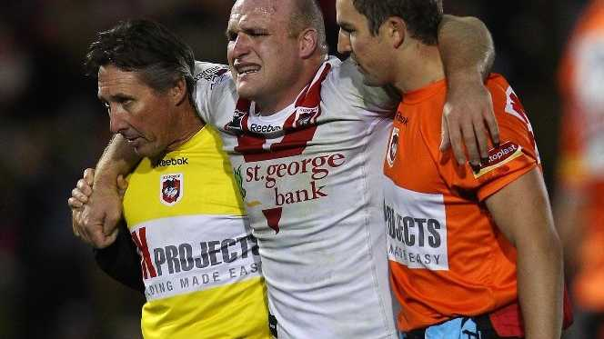Michael Weyman of the Dragons is helped from the field with an injury during the round 10 NRL match between the Penrith Panthers and the St George Illawarra Dragons at Centrebet Stadium on May 14, 2012 in Sydney, Australia