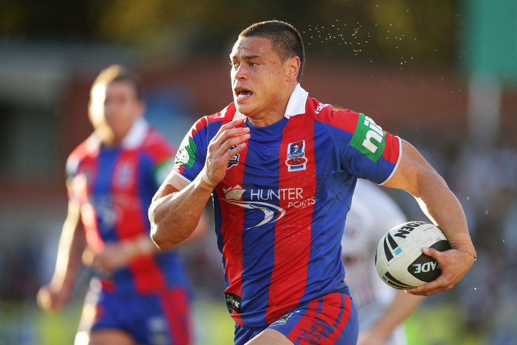 Timana Tahu of the Knights runs with the ball during the round 24 NRL match between the Manly Warringah Sea Eagles and the Newcastle Knights at Brookvale Oval on August 19, 2012 in Sydney, Australia.