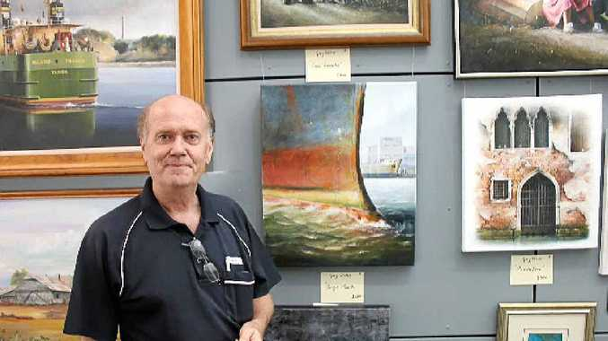 PICTURE OF HEALTH: Richard Jux displays some of the paintings in the Art for Oncology exhibition.
