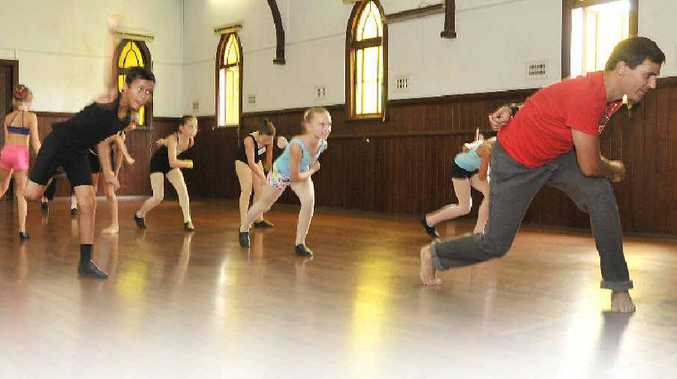 FUN WORKSHOP: Ben Mayne teaching a class at Alstonville Dance Studio (above) and, at left, with young dancers Harmi Davis and Madeline Aspinall.