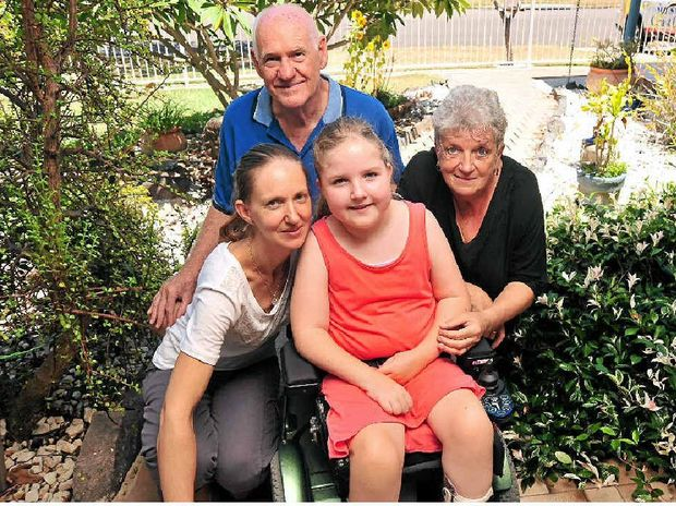 Breanna Medcalfe with her mother Marie and (at rear) Bruce and Het Warrell, who have been raising funds for a new wheelchair.