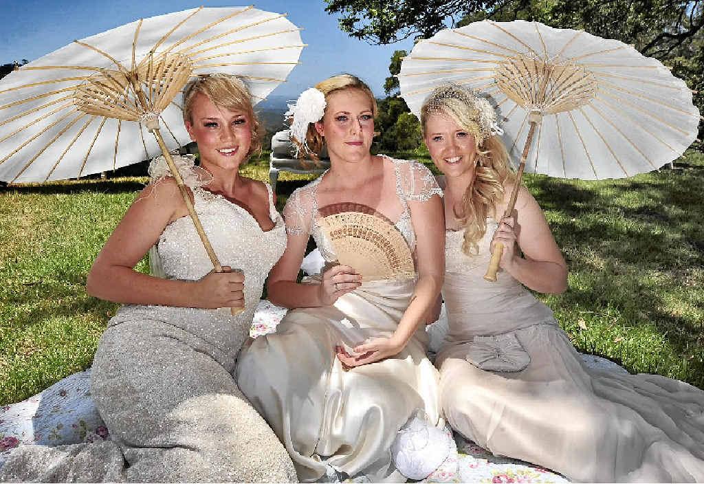 WEDDING BELLES: Bec Martin, Brittany McLeod and Amber Morgan wear Elizabeth de Varga dresses, with hair and make-up by La Bella Brides at the Maleny Montville Wedding Professionals Bridal Showcase.