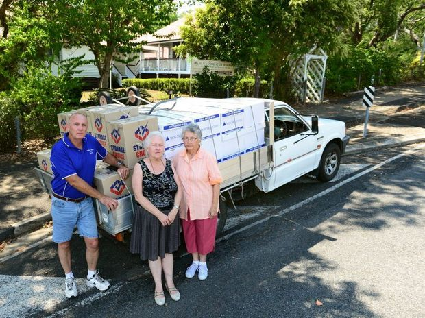 Ipswich Genealogical Society president Chris Lloyd (centre), Councillor Bruce Casos and secretary Audrey Dillon pack up the society's belongings and move from the former Blackstone State School to an uncertain future.