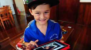 Ronan Kingsbury checks out band photos on his iPad.