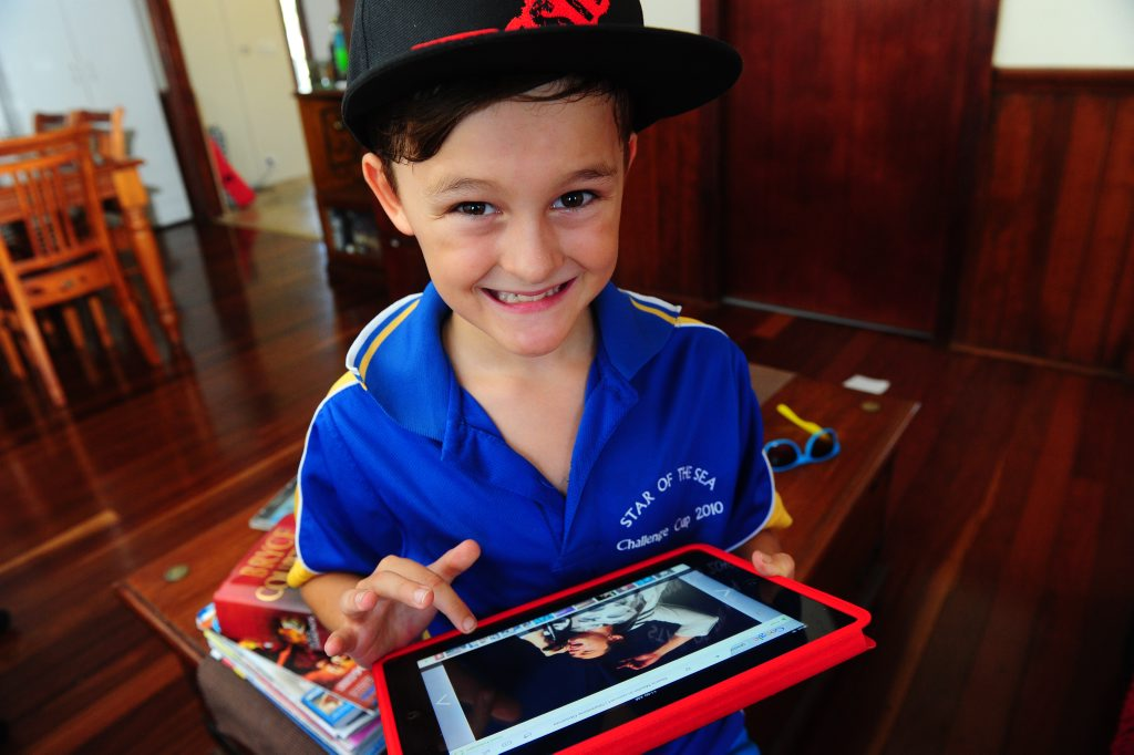 Ronan Kingsbury checks out band photos on his iPad.