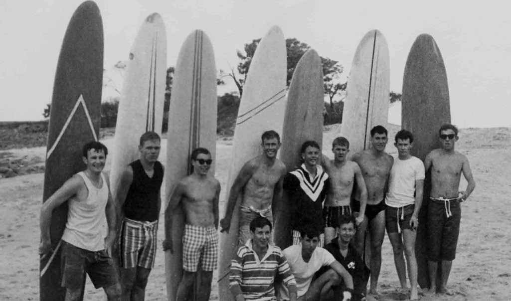 SURFER DUDES: The 1961-62 Angourie Surf Riders Club (back row) Bob Banwell, Cleat McGrath, Roger Maclean, Ray (Duck) Moran, Jeff Solomon, David Winter, Don (Ug) Lee, Kevin Moran, Lane Delong. (seated) Lofty Baldwin, Greg Cox, Brian Alford PHOTO: Henry Donovan