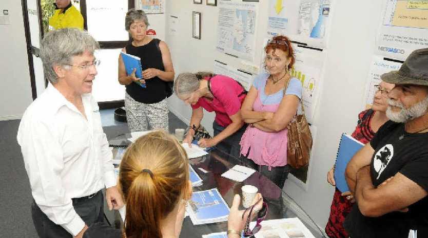 DEBATE: Metgasco CEO Peter Henderson talks with CSG activists at Metgasco's shopfront.