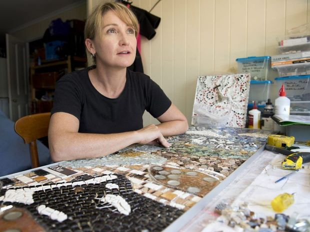 Artist Mary-Kate Khoo has created a mosaic for the walls of The Spotted Cow in remembrance of the 2011 flood .