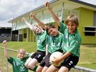 Junior Ipswich Knights Football Club players Celine Mair, Clare Parkes, Ronan McDowell and Riley Smith celebrate the soccer club's new clubhouse. Photo: Claudia Baxter / The Queensland Times