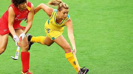 Jordyn Holzberger of Australia and Meiyu Liang of China contest possession in the women's hockey final.