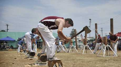 UNDERHANDED EFFORT: Josh Adamson of Caboolture minds his toes as axes make wood chips fly.